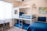 Bedroom 3 is a cool kids space with a bunk bed and a twin