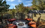 There is a stunning outdoor fire pit ... with red rock views