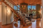 A stunning curved staircase leads to the upper level of the home