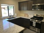 The kitchen has modern stainless steel appliances and upgraded kitchen amenities