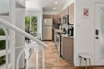 The kitchen is fully equipped with modern appliances and amenities
