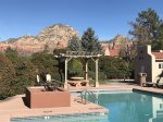 A seasonal communal pool with red rock views is a bonus in the summer months