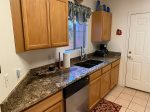 The kitchen is well equipped with a Refrigerator, Electric Oven and Range, Blender, Coffee Maker and Microwave