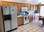 The kitchen is fully-equipped with a Refrigerator, Blender, Coffee Maker, Electric Oven and Range, Microwave, Toaster, Cookware and Dishwasher