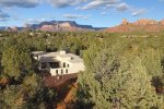An aerial review of this Spanish style Sedona retreat
