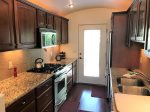 The kitchen is well-equipped with high-end appliances and amenities