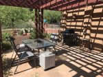 The outdoor patio is shaded by a pergola
