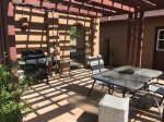 With a dining table and BBQ grill for alfresco dining