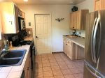 The kitchen is fully equipped with modern appliances and includes a Refrigerator, Gas Stove - Propane, Coffee Maker, Microwave, Toaster, Cookware and Dishwasher