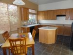 The kitchen has a dining table that seats 4 for planning your Sedona adventures over a sunny breakfast