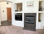 There is a cozy gas fireplace for extra warmth and a flat screen TV for entertainment