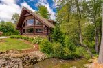 *WALK TO TOWN* Magnificent log home bordering Mill Creek just a block from Main Street.