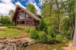 *NEW* Magnificent log home bordering Mill Creek just a block from Main Street.