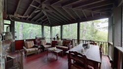Relax in this designer vacation home located minutes from town on beautiful and historic Billy Cabin Road.