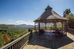 Enjoy spectacular scenic mountain vistas from both inside this lovely vacation home as well as from the large covered decks.