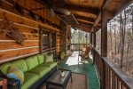 Porch overlooking creek with wood burning fireplace