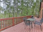 Large deck overlooking wooded backyard
