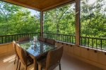 Dining area on screened-in porch