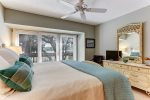 Master bedroom with private balcony overlooking golf course