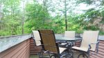 Small back porch for outdoor dinning at Forest Rim Condo in the Heart of Waterville Valley, NH