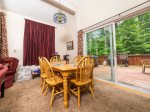 Dining area to Deck All Mountain Rentals in Waterville Estates