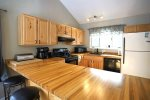 Eat In Kitchen with table and breakfast bar at your vacation rental home in Waterville Estates