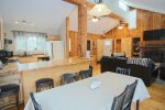 Plenty of room to eat and chat in the kitchen area of your White Mountain vacation home close to Waterville Valley