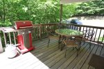 Dining Table with view of porch in Forest Ridge Vacation Home Rental