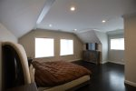 Open Living Room with Large Sectional and Staircase in Coolidge Falls Vacation Rental