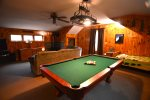 Enjoy fun family game of pool at White Mountain Vacation Home