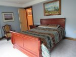 Enjoy your spacious queen bed in this upstairs room