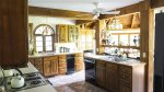 Large open kitchen in a rustic style with craftsman style accents at Waterville Valley Private Vacation Home
