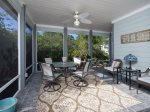 Large screened in porch is a wonderful place visit while cooking dinner on the large gas grill