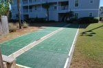 Enjoy a family game of shuffleboard or challenge your friends