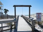 Beautiful boardwalk to the emerald waters of the Gulf of Mexico
