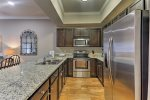 Gorgeous, well stocked kitchen overlooks dining and living areas