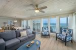 Spacious west-end corner unit has wrap around balcony with stairs directly to the sand