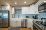 Large, open kitchen is well stocked with toaster, blender, coffee maker and more