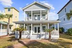 Enjoy front porch sitting and beach breezes
