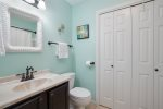 2nd floor master bedroom offers beautiful queen bed and access to screened in porch and wrap around balcony