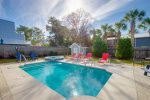 Large screened-in porch that overlooks large backyard and beautiful, private pool and hot tub