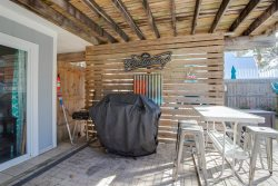 Screened-in porch with big fan to keep the air moving