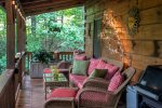 The porch has comfortable seating for 6 with beautiful wicker sofa and matching chairs with foot stools.