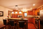 The home has a fully equipped kitchen with bar seating.
