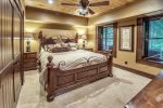 A beautiful Queen bedroom on the main level is suitable for family or guests.