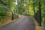 Gently sloped paved road in great condition to the property gate.