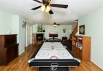 Downstairs game room with air hockey table