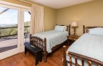 This twin bedroom on the lower level is great for kids or extra guests.