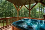 Relax in the private hot tub on the lower deck