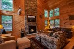 Gorgeous gas, stone fireplace to warm by